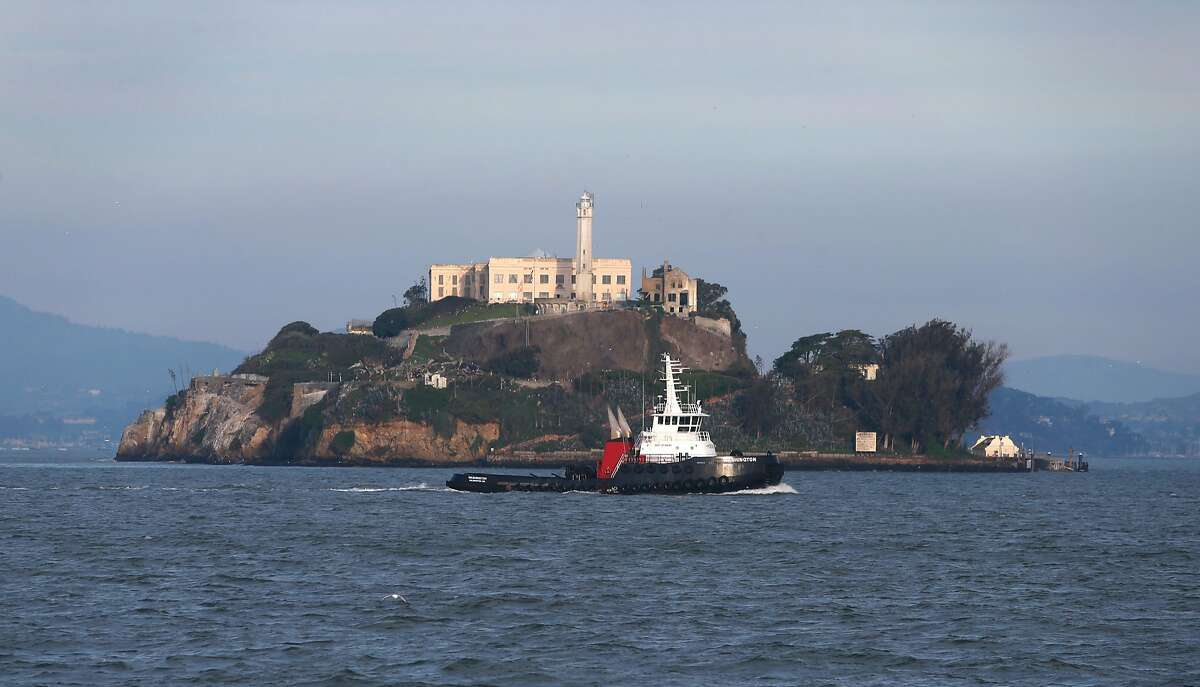 A tugboat passes Alcatraz Island in San Francisco, Calif. on Wednesday, Jan. 27, 2016. Adam Spiegel and his sailing partner were deep in the San Francisco Bay, near Alcatraz when their racing sailboat hit a whale.