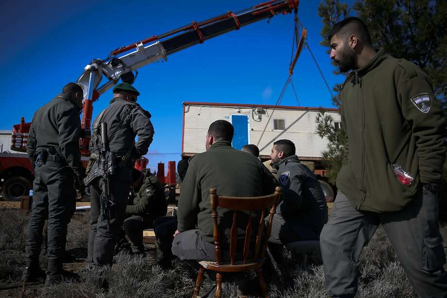Israeli police remove a mobile home from the West Bank settlement outpost of Amona. The settlement was evacuated two years ago, but a small group recently returned there in protest. Photo: Ariel Schalit / Associated Press