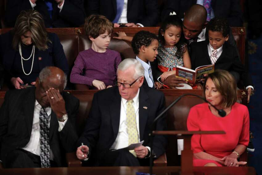WASHINGTON, DC - JANUARY 3: Rep-elect Antonio Delgado (D-NY) reads to children as (Bottom Row, L-R) House Assistant Democratic Leader Rep. James Clyburn (D-SC) , House Minority Whip Steny Hoyer (D-MD), and Speaker-designate Rep. Nancy Pelosi (D-CA) look on during the first session of the 116th Congress at the U.S. Capitol January 03, 2019 in Washington, DC. Under the cloud of a partial federal government shutdown, Pelosi will reclaim her former title as Speaker of the House and her fellow Democrats will take control of the House of Representatives for the second time in eight years.