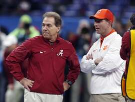 FILE - In this Jan. 1, 2018, file photo, Alabama head coach Nick Saban, left, and Clemson head coach Dabo Swinney talk before the Sugar Bowl semifinal playoff game for the NCAA college football national championship in New Orleans. Swinney and the Tigers play in their third national championship game in four seasons next Monday, Jan. 7, 2019, against top-ranked Alabama.  (AP Photo/Gerald Herbert, File)