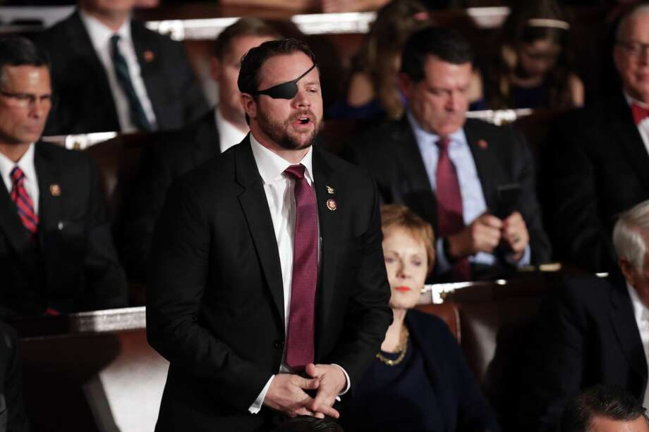 Dan Crenshaw, who on Thursday became the youngest member of Texas' congressional delegation, votes for members of the House leadership, at the Capitol in Washington, D.C. Photo: Chip Somodevilla, Staff / Getty Images / 2019 Getty Images