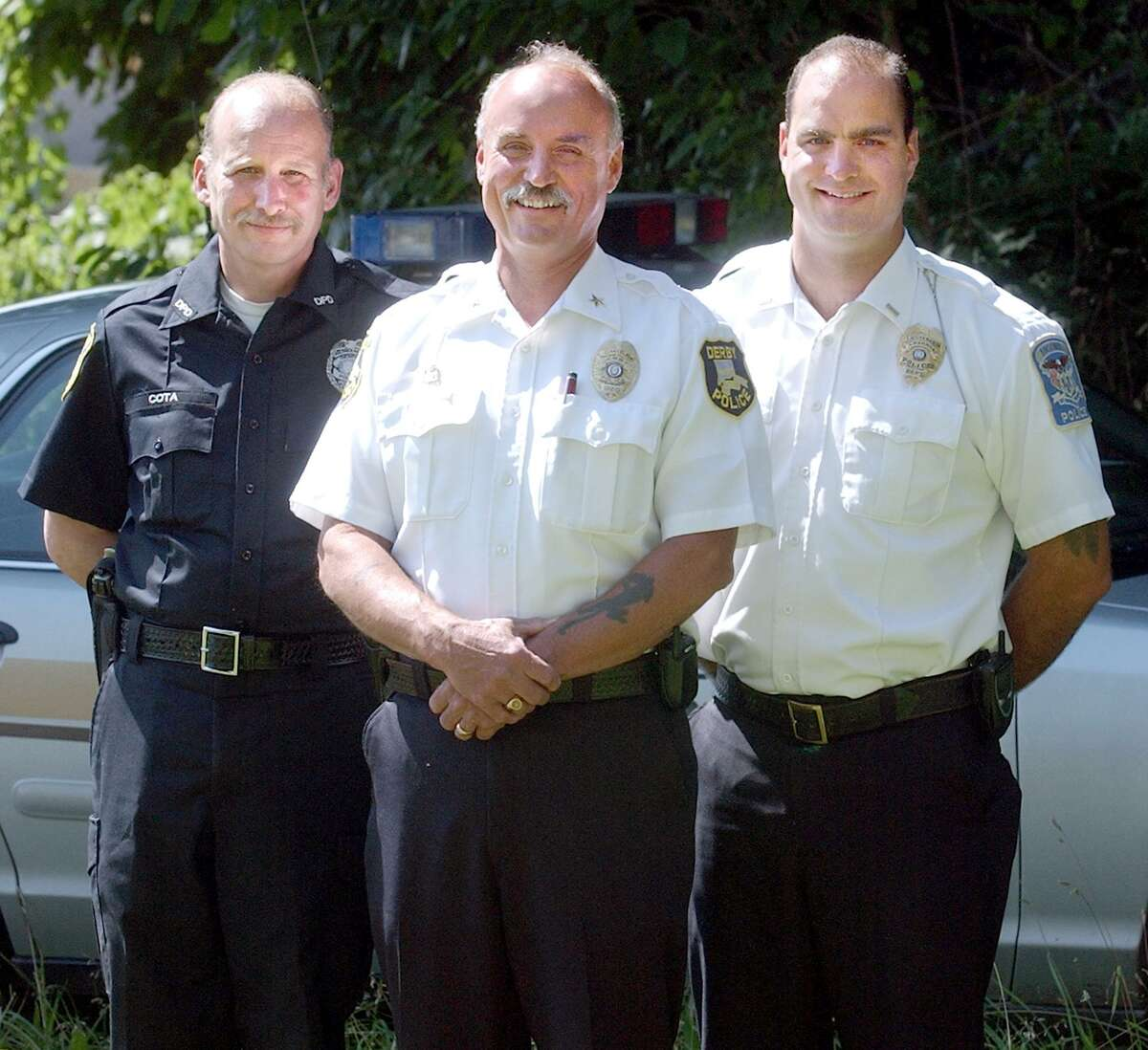 A 2003 photo shows the Cota family in uniform. From left to right the late Allen Cota, who served 25 years as a Derby police officer, his brother Andrew Cota Jr.as Derby Police Chief and Andrew Cota III, a lieutenant in the Ansonia police department who was appointed interim chief of his department beginning Feb. 15.