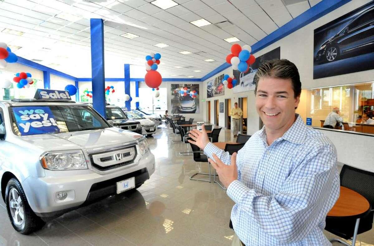 Brian Beanland, general manager of Honda of Danbury, talks inside the showroom, Saturday, July 17, 2010.