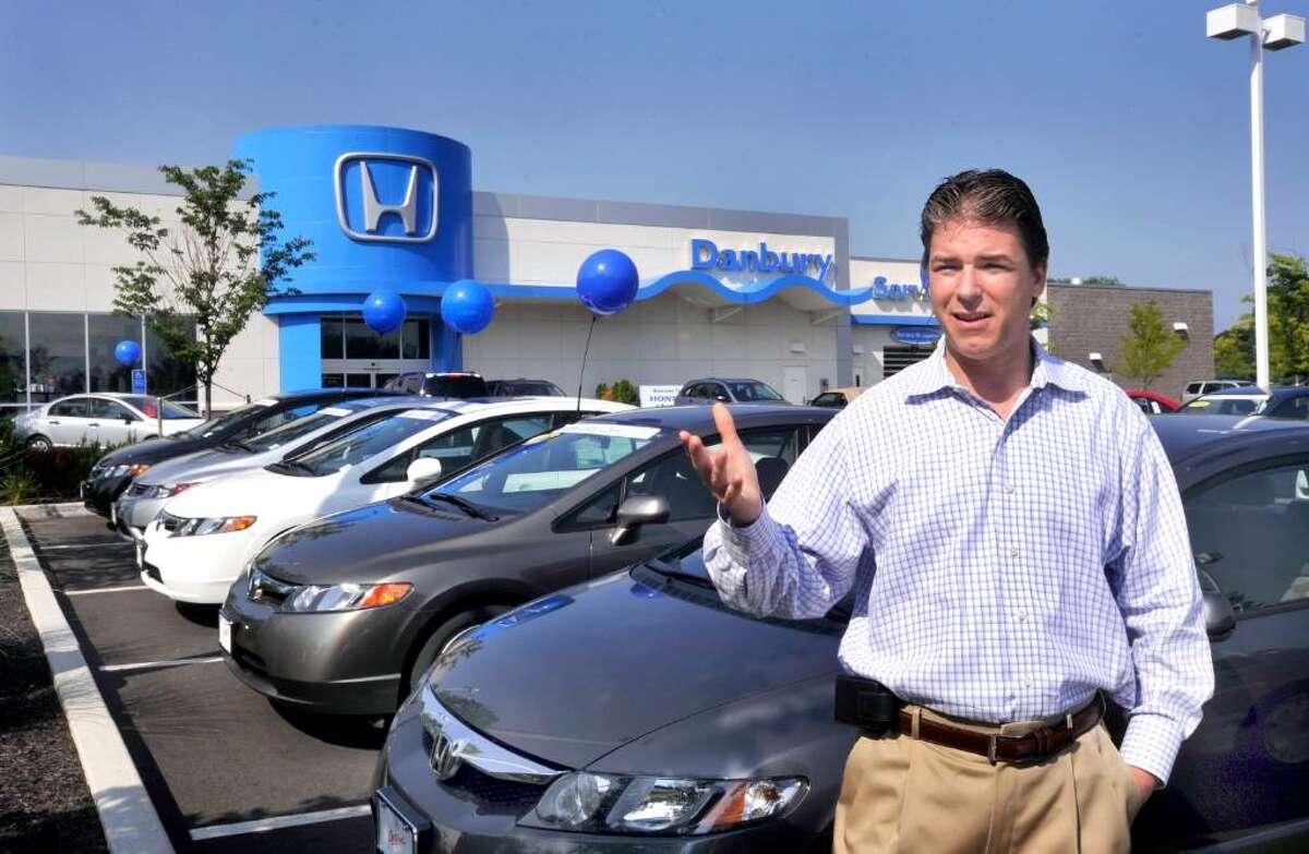 Brian Beanland, general manager of Honda of Danbury, talks outside the showroom, Saturday, July 17, 2010.