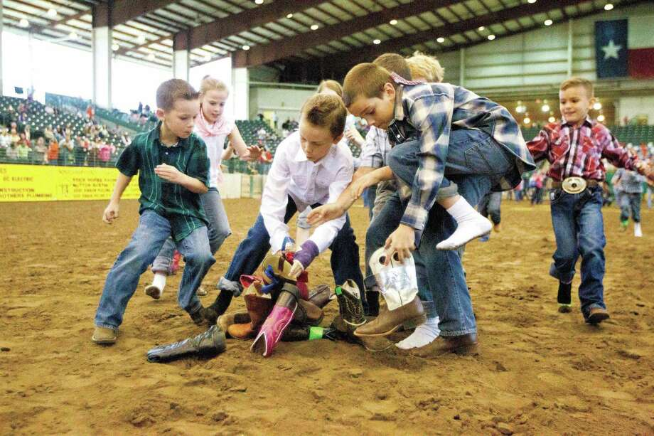 Kids competes in the boot scramble during the youth rodeo at the Montgomery County Fair and Rodeo Friday. To view or purchase this photo and others like it, visit HCNpics.com. Photo: Jason Fochtman