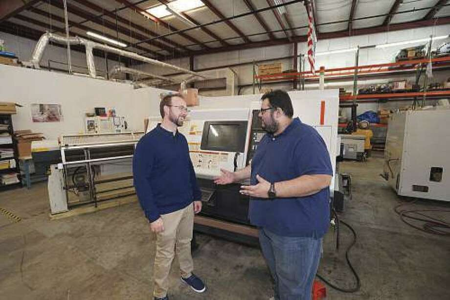Jonathan Alonso (right) landed his position as marketing director at CNC Machines LLC in Sanford, Florida, by helping an overworked sales director in his previous job. Curt Doherty (left), CEO at CNC, is the brother-in-law of the sales director.