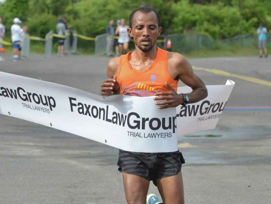EthiopianKemal Birhann Dare crosses the finish line in first place in the Faxon Law Group Fairfield half marathon at Jennings Beach in Fairfield Conn. on Sunday June 3, 2018. Photo: Alex Von Kleydorff / Hearst Connecticut Media / Norwalk Hour