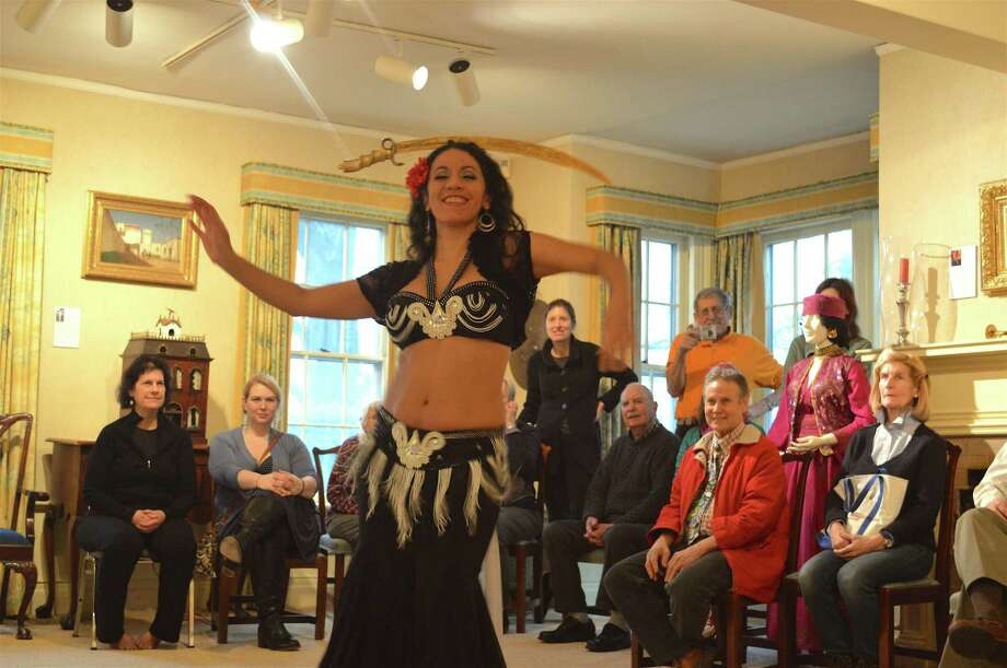 "Tava Naiyin does a sword dance at the New Canaan Historical Society's ""The Art of Belly Dancing with Tava"" program on Sunday, Feb. 11, 2018, in New Canaan. Photo: Jarret Liotta / For Hearst Connecticut Media / New Canaan News Freelance"
