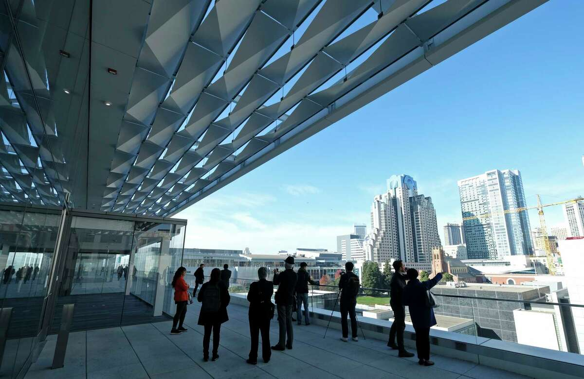 In this file photo, people stand on one of the new terraces and look out at the skyline during the Moscone Center expansion opening Thursday, Jan. 3, 2019, in San Francisco. Completion of the $550 million expansion was celebrated by city officials, tourism industry leaders and neighborhood stakeholders. Mayor London Breed said that the downtown structure will better meet the needs of tourism even as the city struggles with homelessness.