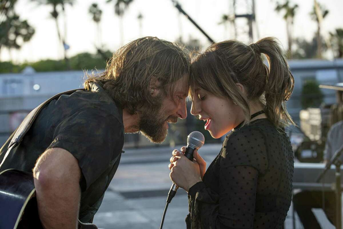 """This image released by Warner Bros. shows Bradley Cooper, left, and Lady Gaga in a scene from the latest reboot of the film, """"A Star is Born."""" The film led nominations for the 25th Screen Actors Guild Awards with four nods including best ensemble on Wednesday, firmly establishing Bradley Cooper's romantic revival as this year's Academy Awards front runner. (Neal Preston/Warner Bros. via AP)"""