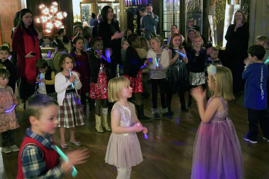 Kids enjoy the celebration at the New Year's Eve Family Fun Night at Waveny House on Monday in New Canaan. Photo: Jarret Liotta / For Hearst Connecticut Media / New Canaan News Freelance