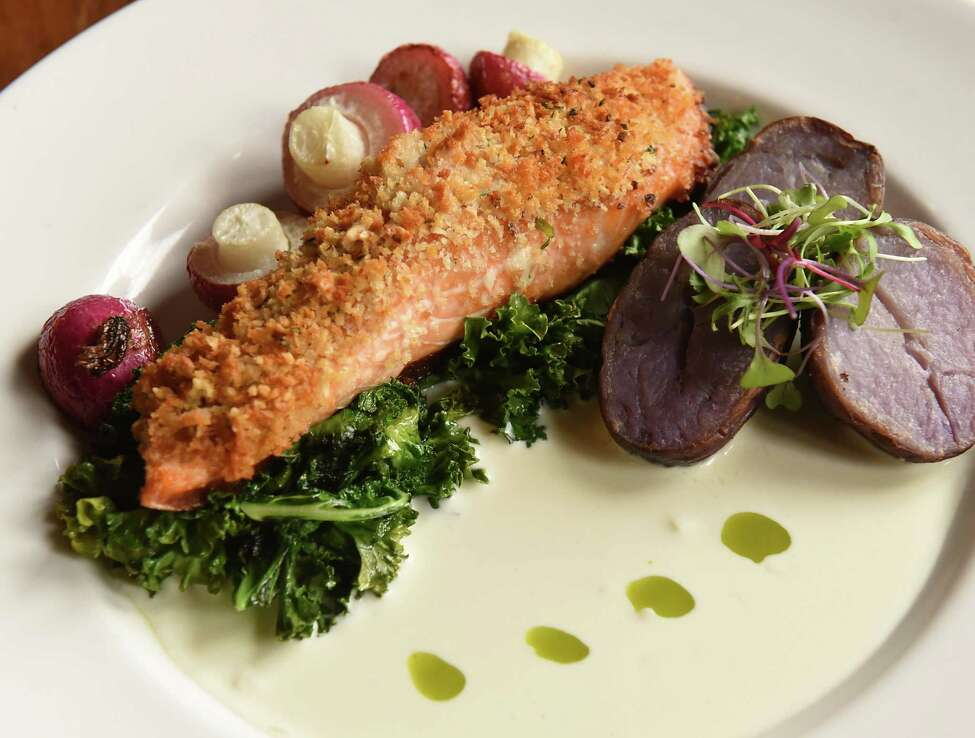Panko and peanut crusted Faroe Island salmon, organic miso-honey glaze, roasted potatoes, seasonal vegetables, yuzu cream at Vanderbilt Lakeside on Thursday, Dec. 20, 2018 in Philmont, N.Y. (Lori Van Buren/Times Union)