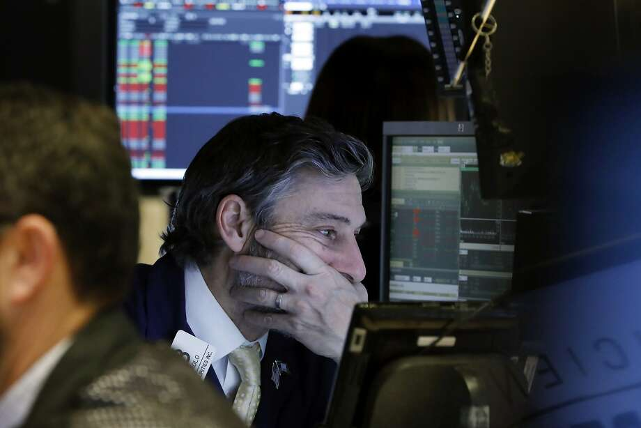 Trader John Romolo works on the floor of the New York Stock Exchange, Thursday, Jan. 3, 2019. Stocks went into a steep slide Thursday after Apple sent a shudder through Wall Street with word that iPhone sales in China are falling. (AP Photo/Richard Drew) Photo: Richard Drew / Associated Press