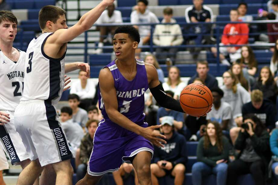 Humble junior guard Malik Nash, right, works for a pass against Kingwood sophomore Billy Gould, left, during the 4th quarter of their District 22-6A matchup at KHS on Jan. 2, 2019. Photo: Jerry Baker, Houston Chronicle / Contributor / Houston Chronicle