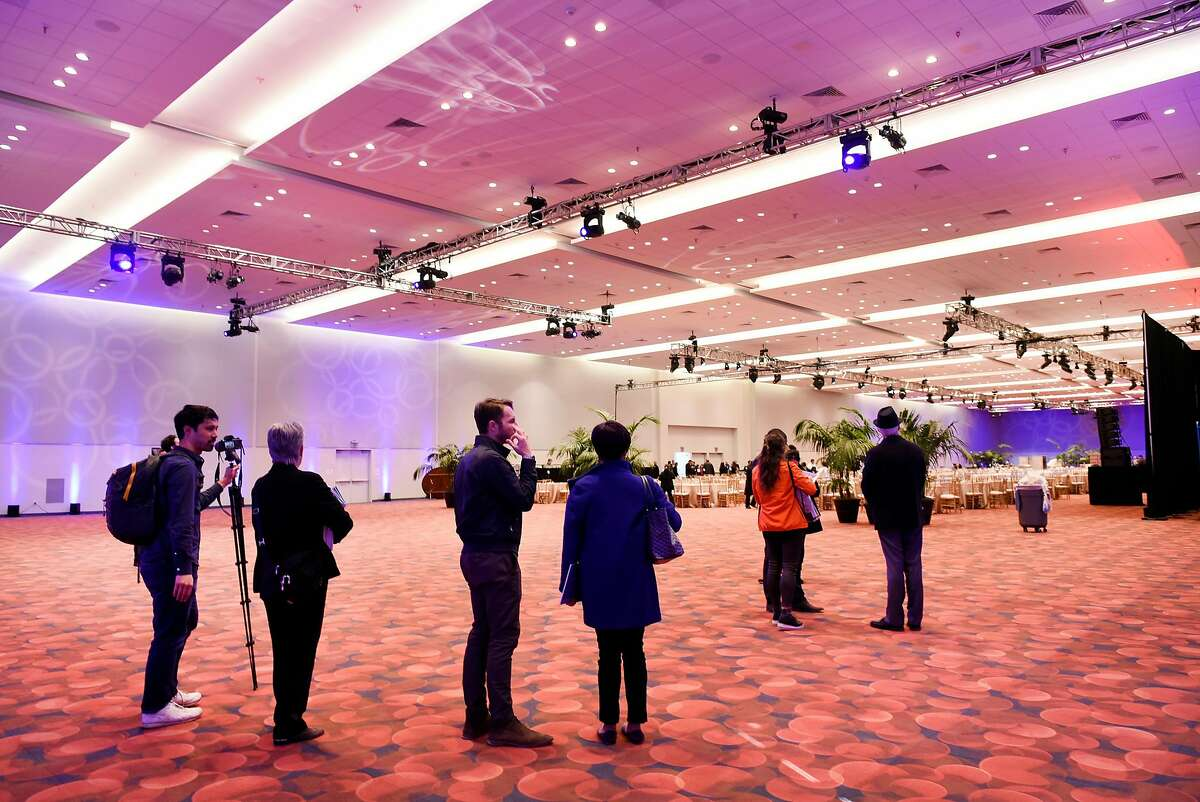 Guests tour the main 50,000 square foot ballroom during a grand re-opening of the newly renovated Moscone Center in San Francisco, Calif., on Thursday, January 3, 2019.