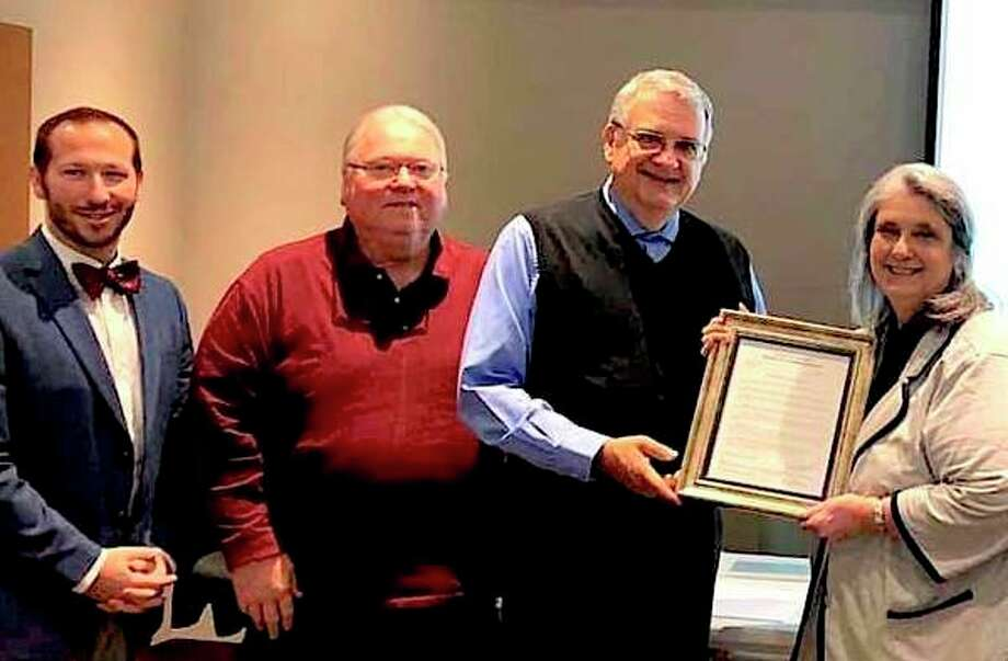 Mary Drier was recently honored at a Tuscola County Board of Commissioners meeting. (From left) Tuscola County Commissioners Matthew Bierlein, Tom Young and Thom Bardwell presented Drier with a resolution for her years of covering the Thumb as a journalist. (Submitted Photo)