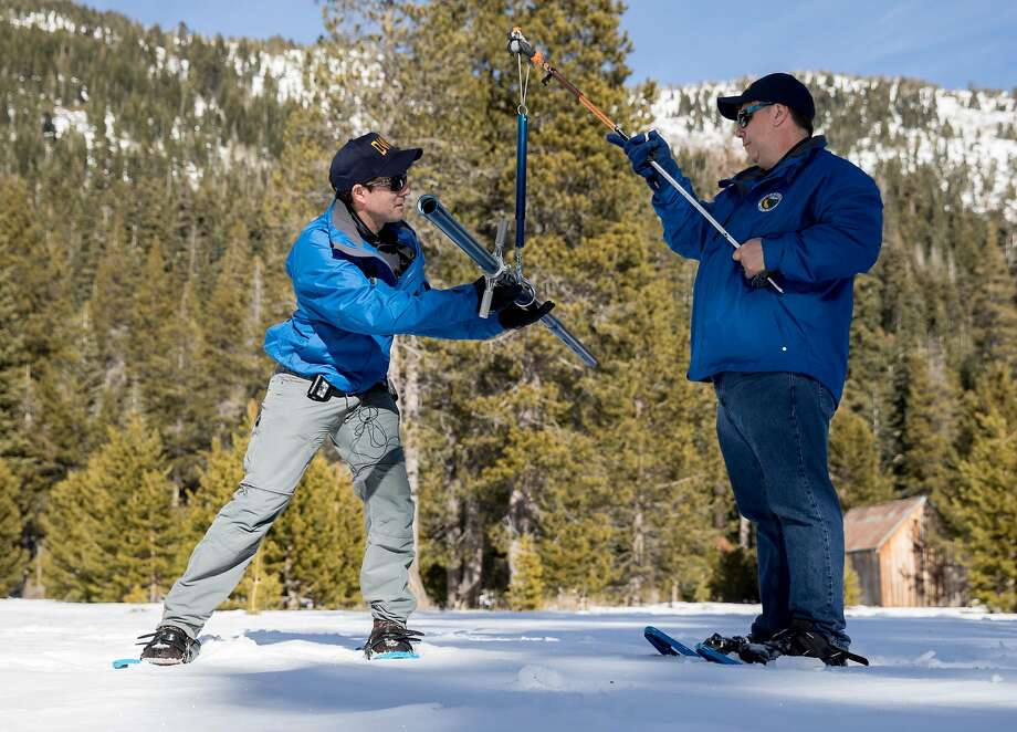 Water Resources Department engineer John King, left, and climatologist Michael Anderson take snow measurements. Photo: Jessica Christian / The Chronicle