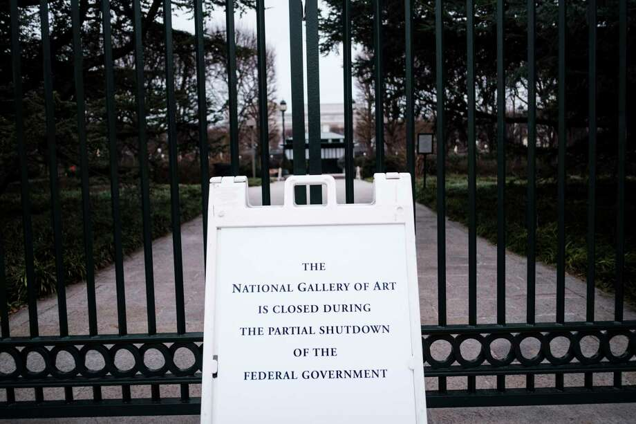Signs outside the National Gallery of Art Sculpture Garden notifying the public it was closed, along with other Smithsonian museums, on the 13th day of a government shutdown, in Washington, Jan. 3, 2019. (Pete Marovich/The New York Times) Photo: PETE MAROVICH / NYTNS