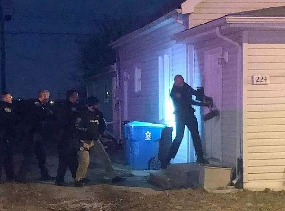 Wood River police force entry into a house in the 200 block of East Ferguson Avenue early last Friday to execute a drug-related search warrant.