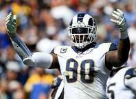 LOS ANGELES, CA - SEPTEMBER 16:  Michael Brockers #90 of the Los Angeles Rams reacts to the crowd during the game against the Arizoa Cardinals at Los Angeles Memorial Coliseum on September 16, 2018 in Los Angeles, California.  (Photo by Harry How/Getty Images)