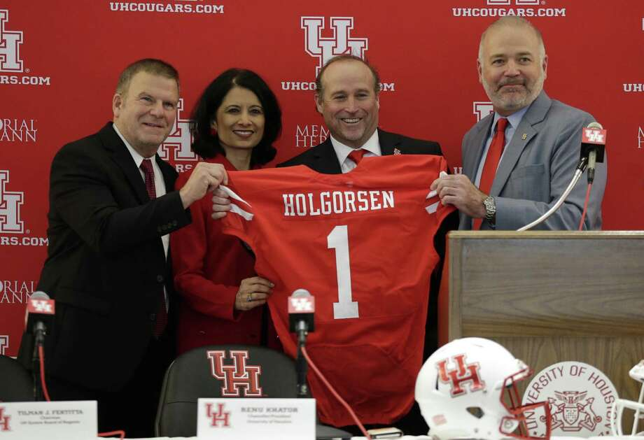 From left, Tilman J. Fertitta, Chairman UH System Board of Regents, Renu Khatur, Chancellor/President University of Houston, Dana Holgorsen, head coach University of Houston and Chris Pezman, Vice President for Intercollegiate Athletics University of Houston during a press conference to name Dana Holgorsen the new head coach of the University of Houston football team on January 03, 2019 in Houston, Texas. Photo: Bob Levey, Stringer / Getty Images / 2019 Getty Images