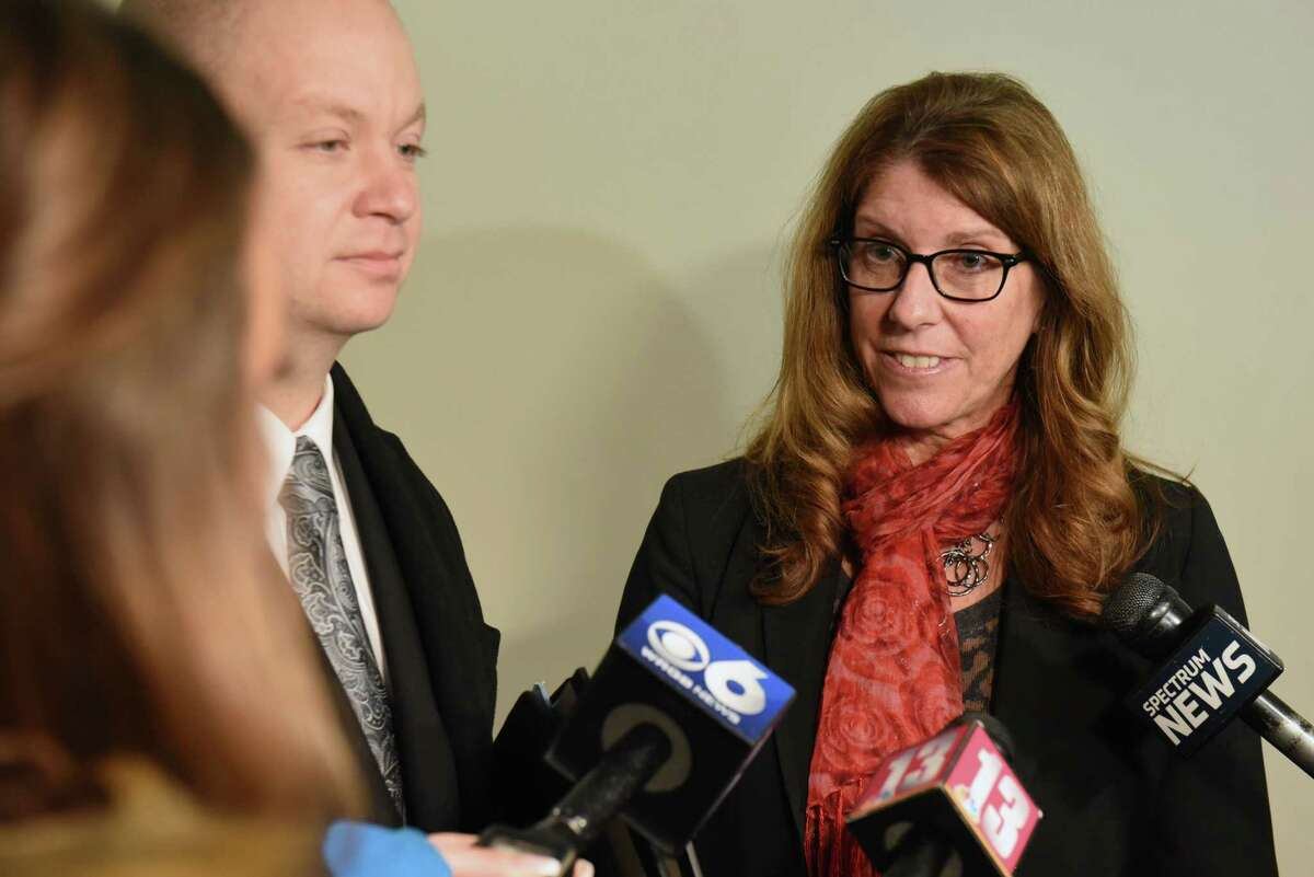 Troy City Council President Carmella Mantello, right, and her attorney William Roberts talk to the press after Mantello pleaded guilty at her arraignment on misdemeanor DWI charges at Clifton Park Town Court on Thursday, Jan. 3, 2019 in Clifton Park, N.Y. (Lori Van Buren/Times Union)