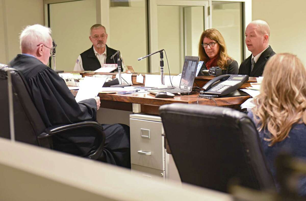 Troy City Council President Carmella Mantello and her attorney William Roberts listen to Judge James Hughes during Mantello's arraignment on misdemeanor DWI charges at Clifton Park Town Court on Thursday, Jan. 3, 2019 in Clifton Park, N.Y. (Lori Van Buren/Times Union)
