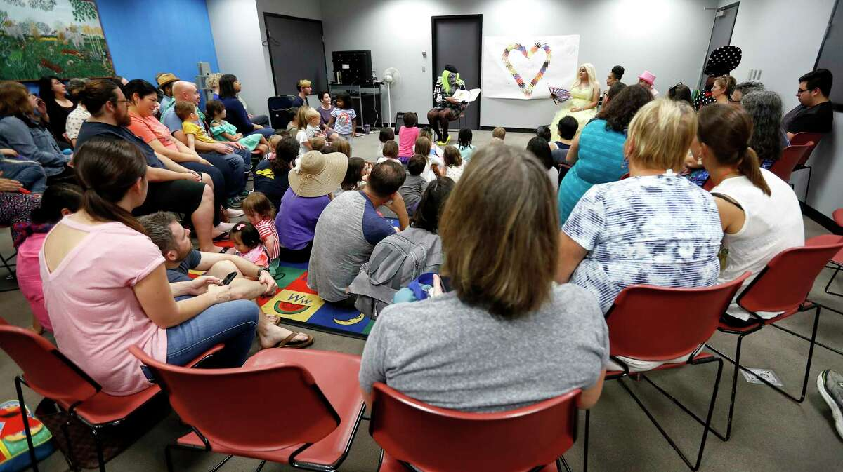 Vincent reads a book to adults and children during the monthly Drag Queen Story Time at Freed-Montrose Neighborhood Library, Saturday, September 29, 2018, in Houston. Saturday marked the one-year anniversary of the story hour, which happens on the last Saturday of every month.