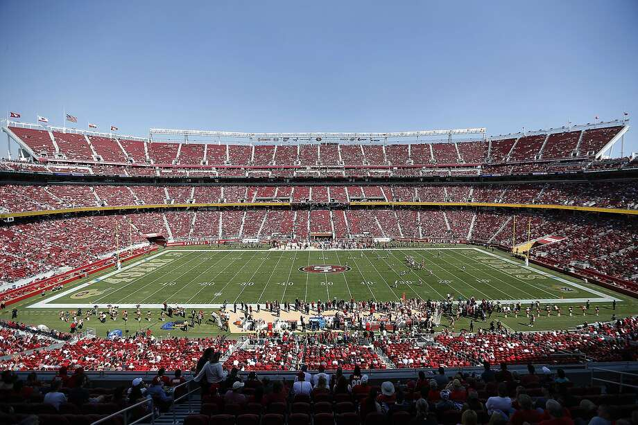 In this Oct. 7, 2018, file photo, fans watch an NFL football game between the San Francisco 49ers and the Arizona Cardinals at Levi's Stadium in Santa Clara, Calif. With the College Football Playoff title game located thousands of miles away from the two campuses in Alabama and South Carolina, possible fatigue for fan bases of teams that have become annual participants in the playoff and a game site in an expensive market lacking college football die-hards, prices for tickets for Monday night's championship game in Santa Clara have been plummeting the past few days. (AP Photo/Tony Avelar) Photo: Tony Avelar, Associated Press
