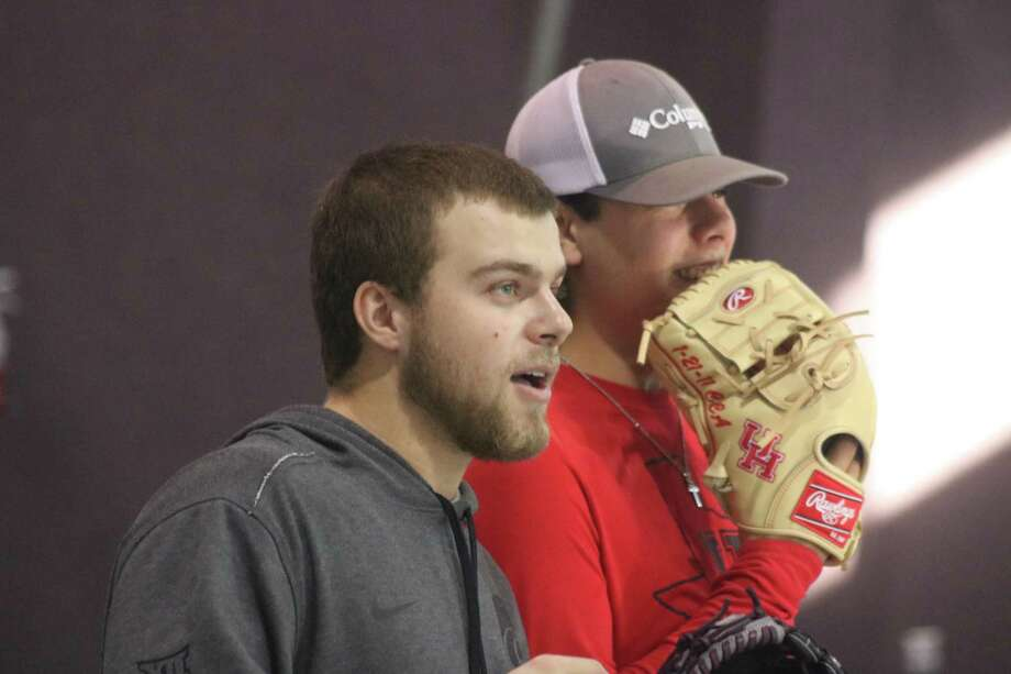 As they watch campers at the Holiday Baseball Camp play a game in the Deer Park United Methodist Gymnasium, Cameron Thompson (left) and Clay Aguilar are prepared to make the 2019 collegiate campaign their best yet. Photo: Robert Avery