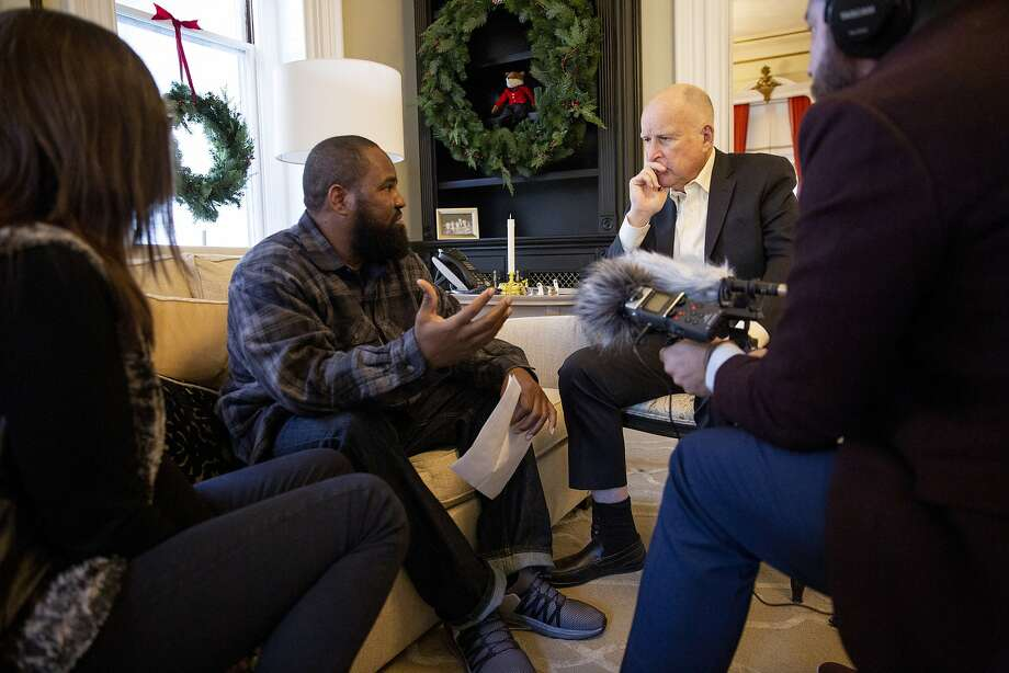 California Gov. Jerry Brown (right) is interviewed by Earlonne Woods and the Ear Hustle podcast team on Thursday, Jan. 3, 2019, in Sacramento, Calif. Photo: Santiago Mejia / The Chronicle