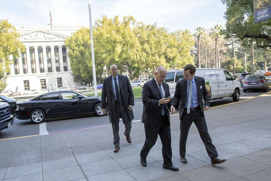 California Gov. Jerry Brown with his press secretary Evan Westrup (right) and his security detail as they escort Gov. Brown to swear in a new California Supreme Court Justice at the Stanley Mosk Courts Building on Thursday, Jan. 3, 2019, in Sacramento, Calif. Photo: Santiago Mejia / The Chronicle
