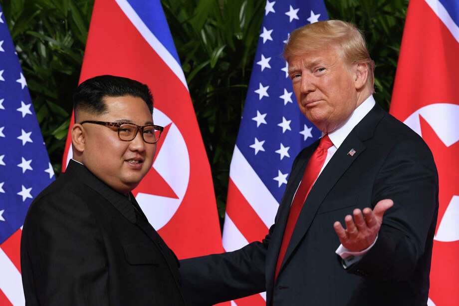 President Donald Trump gestures as he meets with North Korea's leader Kim Jong Un June 12 at the start of their historic US-North Korea summit, at the Capella Hotel on Sentosa island in Singapore. Count this opening as one of Trump's success, but so has been his refusal to play the North Korean leaders' usual game. Photo: SAUL LOEB /AFP /Getty Images / AFP or licensors