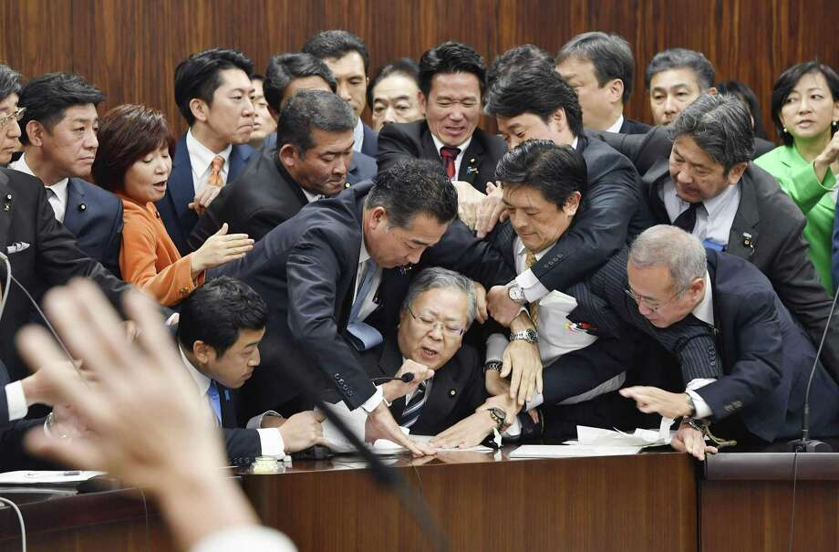 Japan's lawmakers scuffle Dec.8 over a bill that would revise an immigration control law. Meanwhile, the U.S., facing many of the same worker shortages, is actively anti-immigration. Photo: Yoshitaka Sugawara /Associated Press / Kyodo News