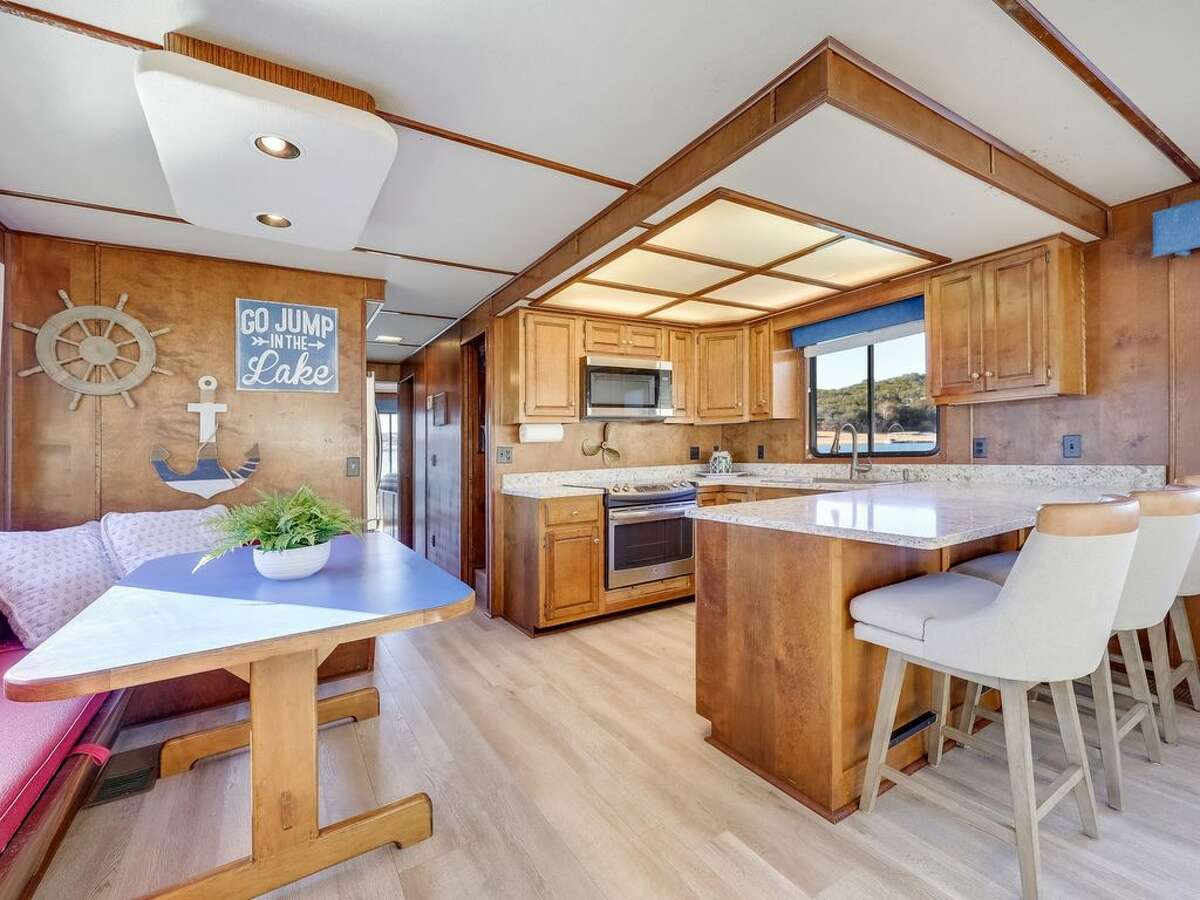 The interior of the boat has a kitchen, and a...
