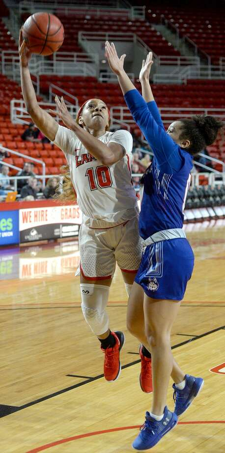 Lamar's Chastadie Barrs shoots over the efforts of Houston Baptist's Takara Wade during the Lady Cardinals' Southland Conference home opener Wednesday.  Photo taken Wednesday, January 2, 2019 Photo by Kim Brent/The Enterprise Photo: Kim Brent/The Enterprise