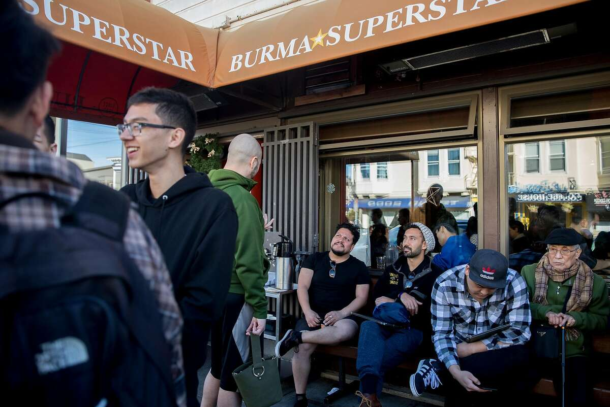 Dozens wait in line for a table at Burma Superstar near 4th Avenue and Clement Street in the Richmond District of San Francisco, Calif. Wednesday, Dec. 26, 2018.