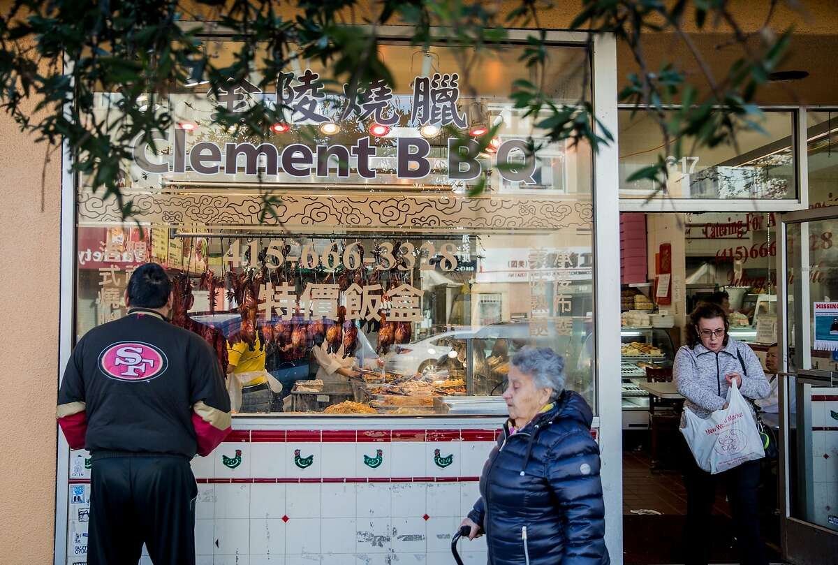 People shop at Clement BBQ along Clement Street in the Richmond District of San Francisco, Calif. Wednesday, Dec. 26, 2018.