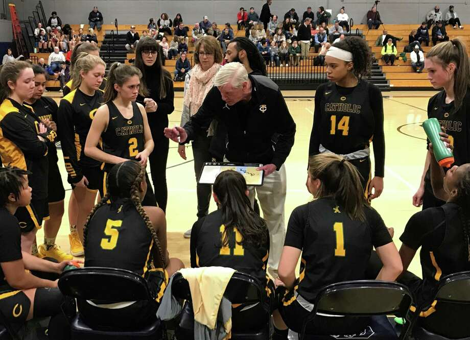 Trinity Catholic girls basketball coach Mike Walsh speaks to his team during a timeout against Staples on Thursday, Jan. 3, 2019 in Westport, Conn. Walsh, who won multiple FCIAC and state titles as the boys basketball coach at Trinity, picked up his first win as girls coach with a 68-49 win. Photo: Scott Ericson / Hearst Connecticut Media / Contributed Photo / Greenwich Time Contributed