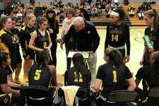 Trinity Catholic girls basketball coach Mike Walsh speaks to his team during a timeout against Staples on Thursday, Jan. 3, 2019 in Westport, Conn. Walsh, who won multiple FCIAC and state titles as the boys basketball coach at Trinity, picked up his first win as girls coach with a 68-49 win.