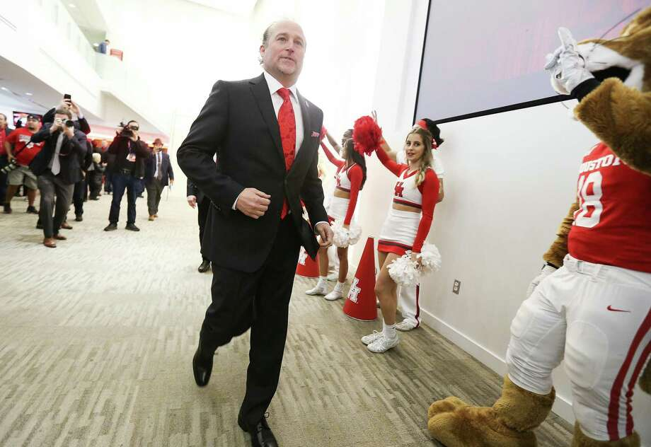 Dana Holgorsen hustles to the Jan. 3 news conference at TDECU Stadium that announces his arrival as the new UH football coach. He considers it his dream job. Photo: Elizabeth Conley, Houston Chronicle / Staff Photographer / © 2018 Houston Chronicle