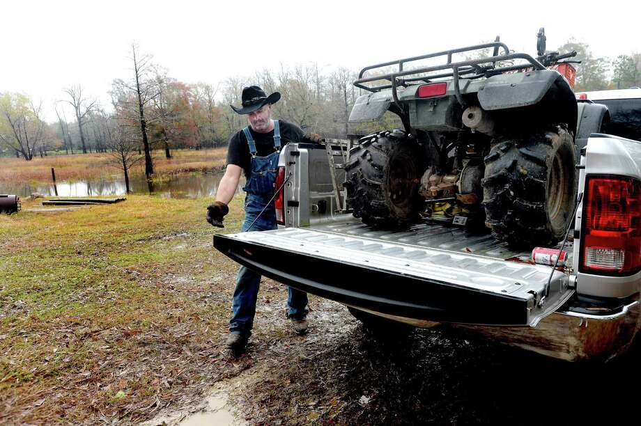 Slade Strickland loads valuables that had remained stored at his former homesite in Deweyville while preparing for another potential episode of flooding following days of heavy rain and an expected increased dam release at Toledo Bend by the Sabine River Authority. Strickland moved his family's home to higher ground after it flooded, but still had items stored at the shed, including an ATV and boat. Flooding had already begun at low-lying areas on the property, and Strickland expected it to enter the shed, particularly following the increased opening of the dam gate. 