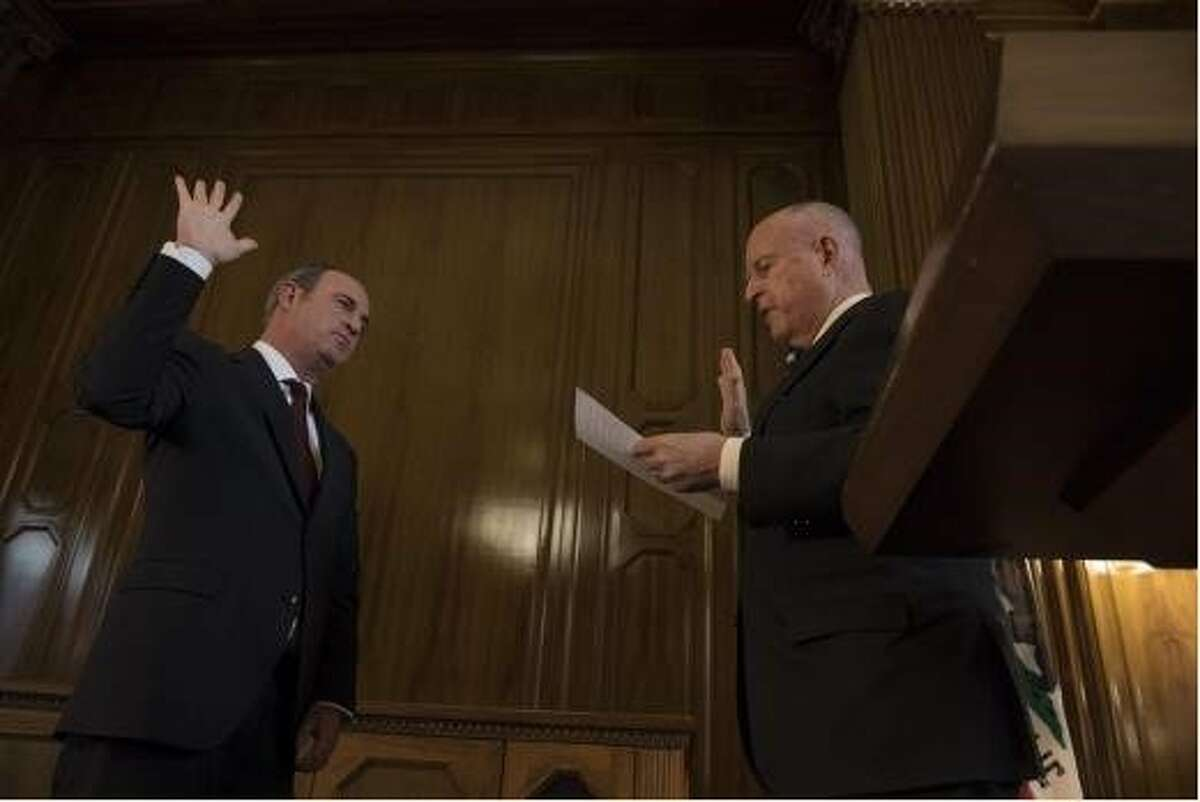 Gov. Jerry Brown swears in California Supreme Court Justice Joshua Groban in January 2019