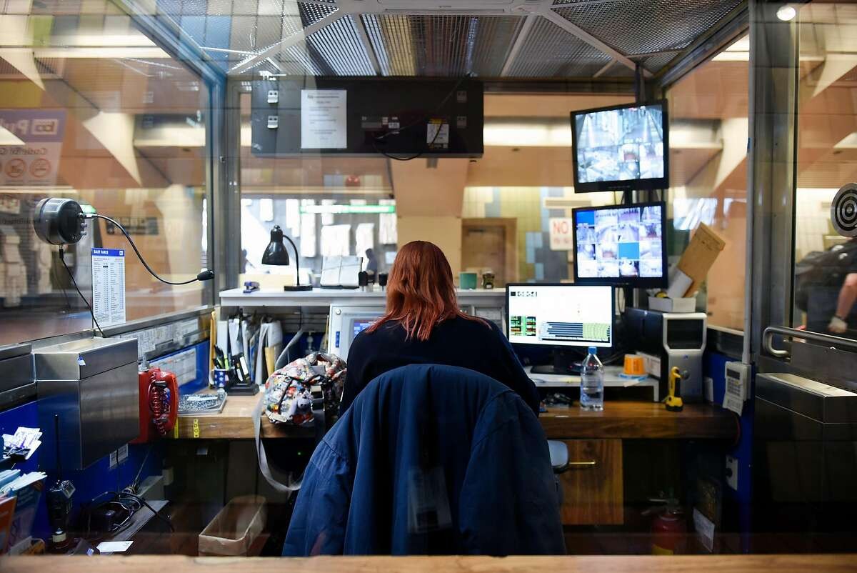 A BART station agent is seen in booth at the 16th St. station in San Francisco, Calif., on Thursday, January 3, 2019.
