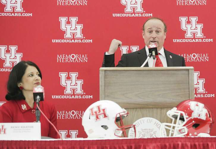 University of Houston's new head football coach, Dana Holgorsen, gives a speech as UH Chancellor Renu Khator listens, during his press conference at TDECU Stadium on Thursday, Jan. 3, 2019 in Houston.