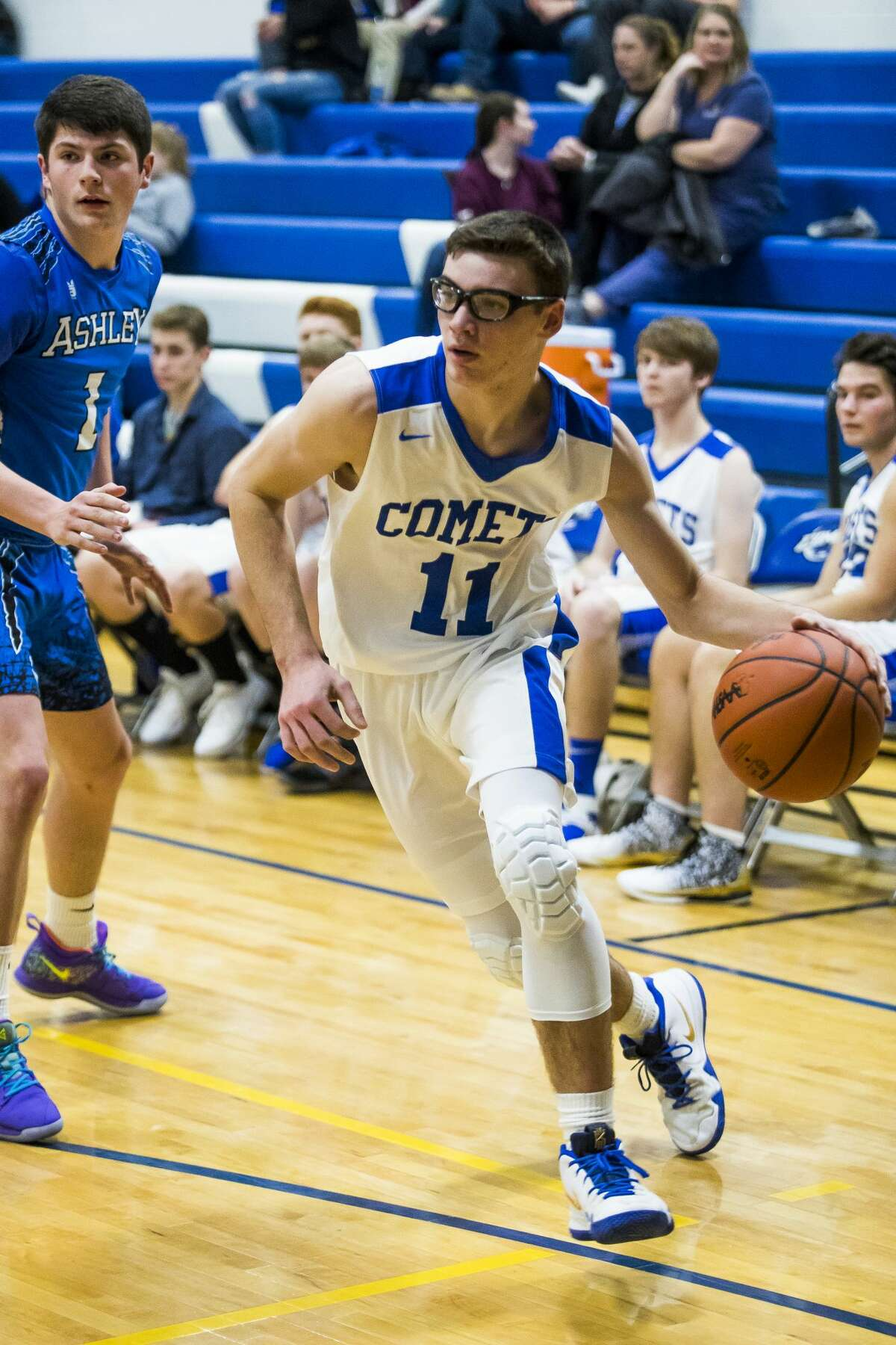 Coleman junior Connor Arnold dribbles toward the basket during a game against Ashley on Thursday, Jan. 3, 2019 at Coleman High School. (Katy Kildee/kkildee@mdn.net)