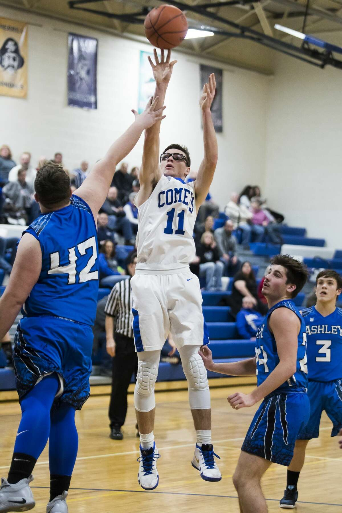 Coleman junior Connor Arnold takes a shot during a game against Ashley on Thursday, Jan. 3, 2019 at Coleman High School. (Katy Kildee/kkildee@mdn.net)