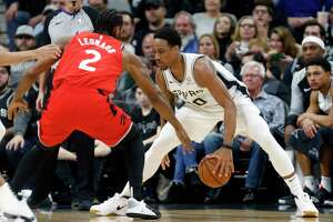 SAN ANTONIO, TX - JANUARY 3:  DeMar DeRozan #10 of the San Antonio Spurs is guarded by  Kawhi Leonard #2 of the Toronto Raptors before the opening tip-off at AT&T Center on January 3, 2019 in San Antonio, Texas.  NOTE TO USER: User expressly acknowledges and agrees that , by downloading and or using this photograph, User is consenting to the terms and conditions of the Getty Images License Agreement.