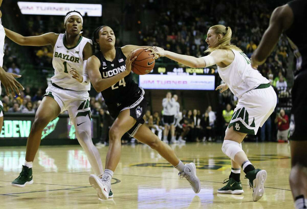 UConn's Napheesa Collier (24) dribbles between Baylor's NaLyssa Smith (1) and Lauren Cox (15) during the Thursday night's in Waco, Texas.