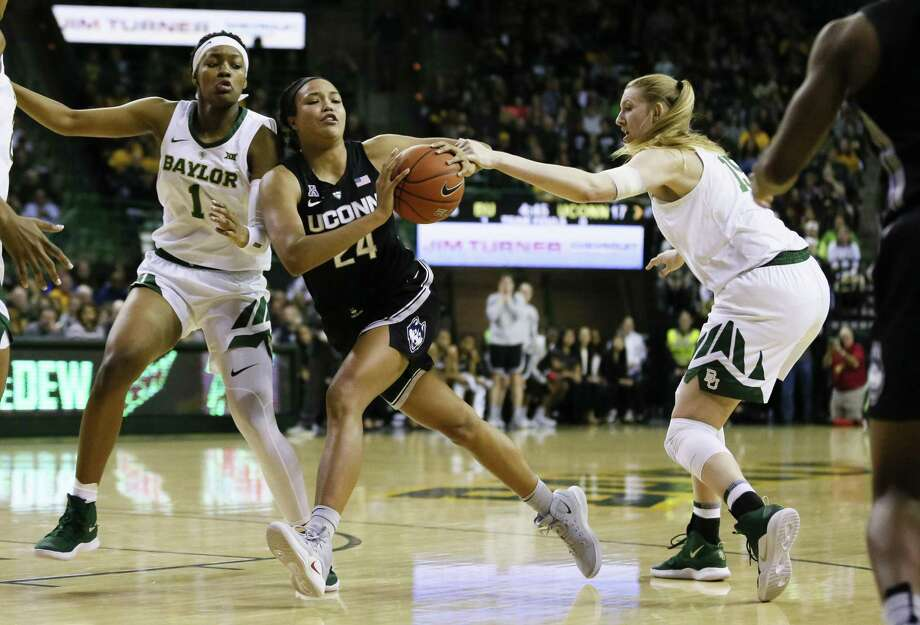UConn's Napheesa Collier (24) dribbles between Baylor's NaLyssa Smith (1) and Lauren Cox (15) during the Thursday night's in Waco, Texas. Photo: Ray Carlin / Associated Press / Copyright 2019 The Associated Press. All rights reserved.